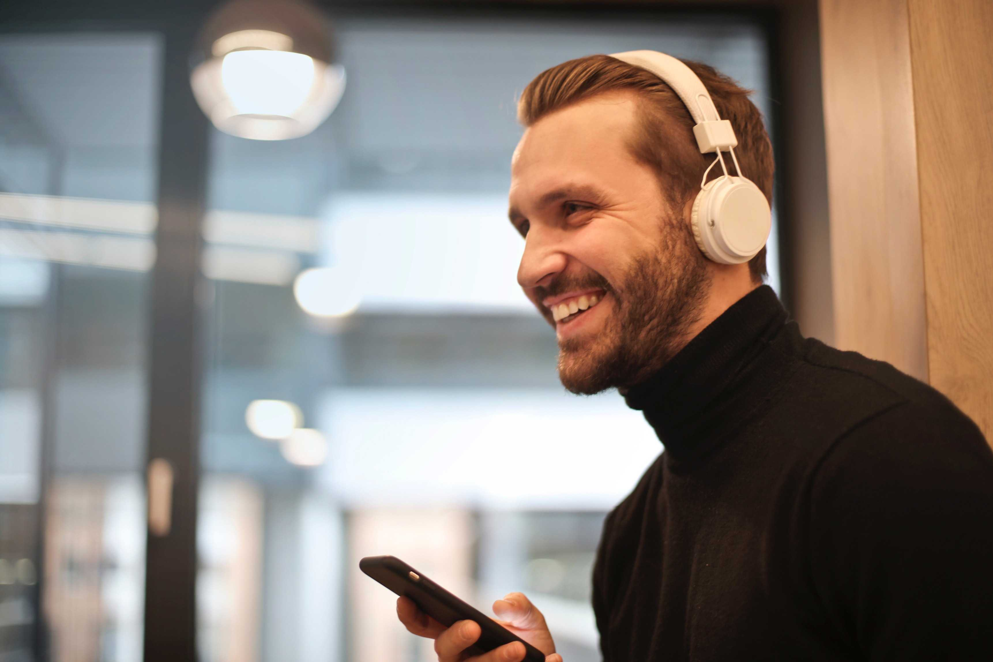 Man speaking on phone with headphones