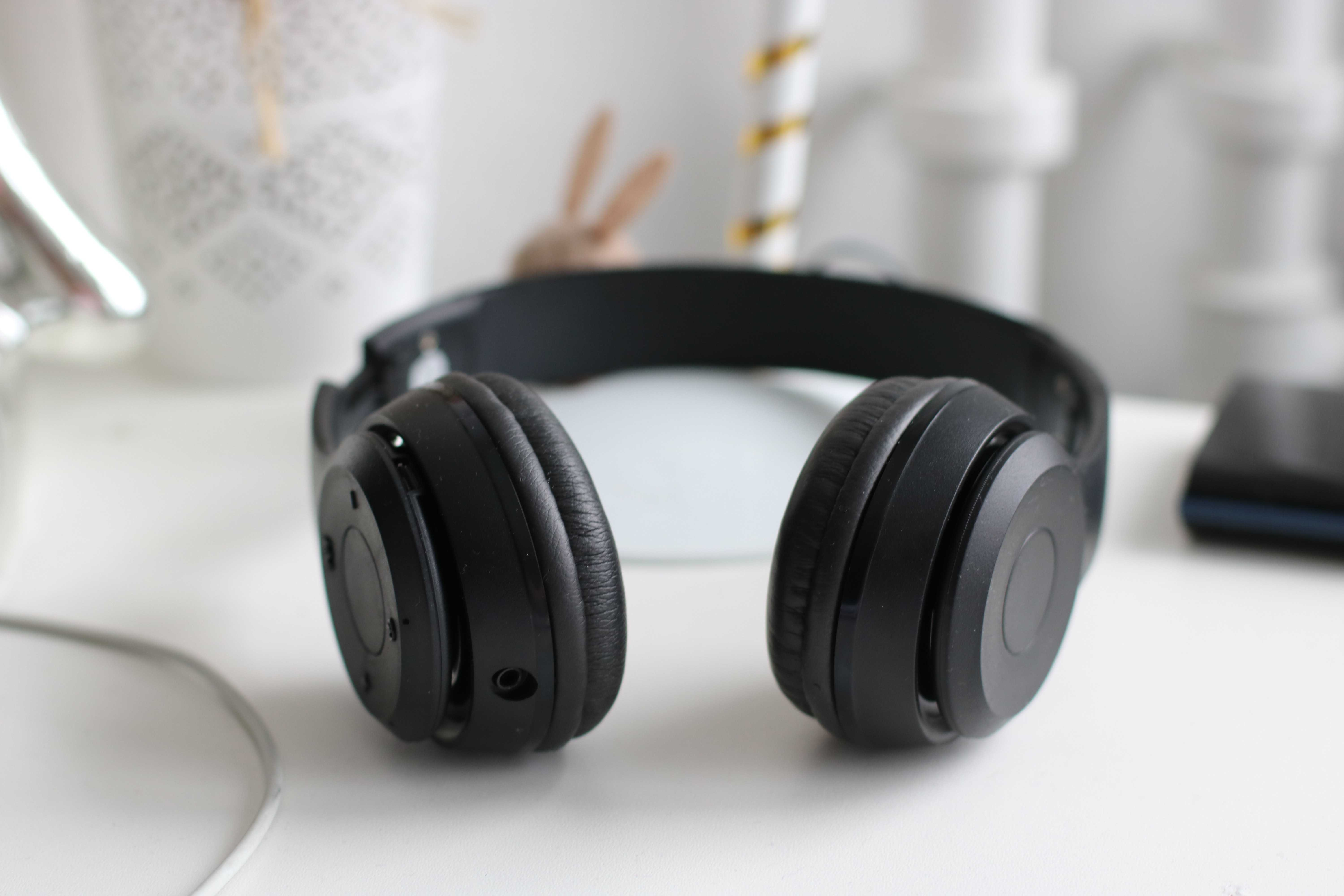 black noise cancelling headphones on a table