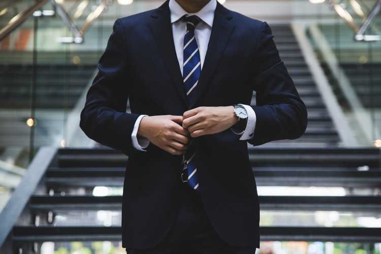 remote worker in a suit breaking stereotype
