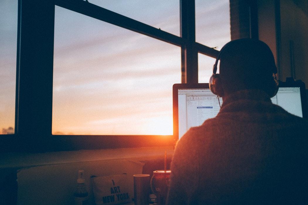man working in headphones