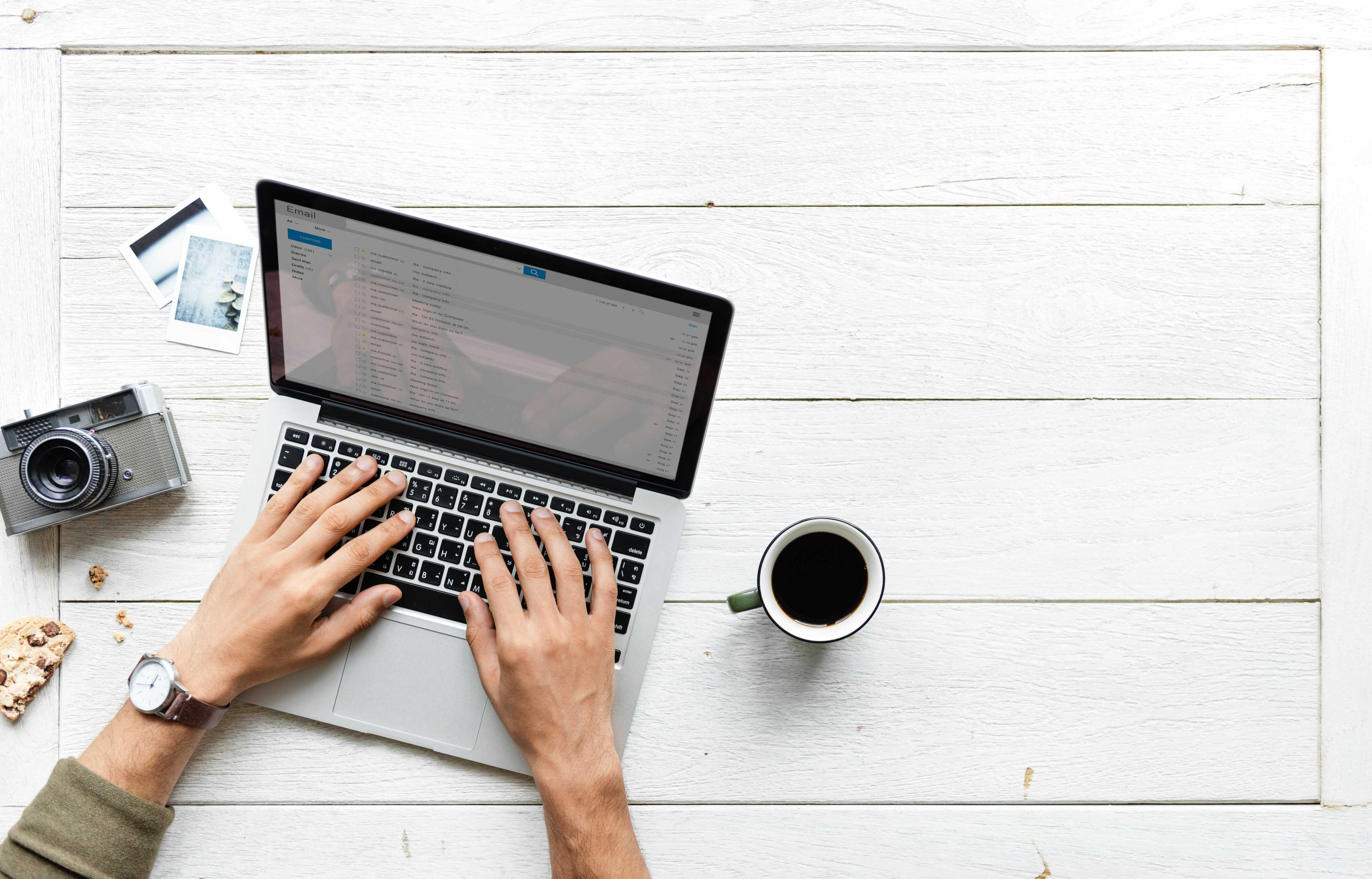Digital nomad working on a laptop with coffee