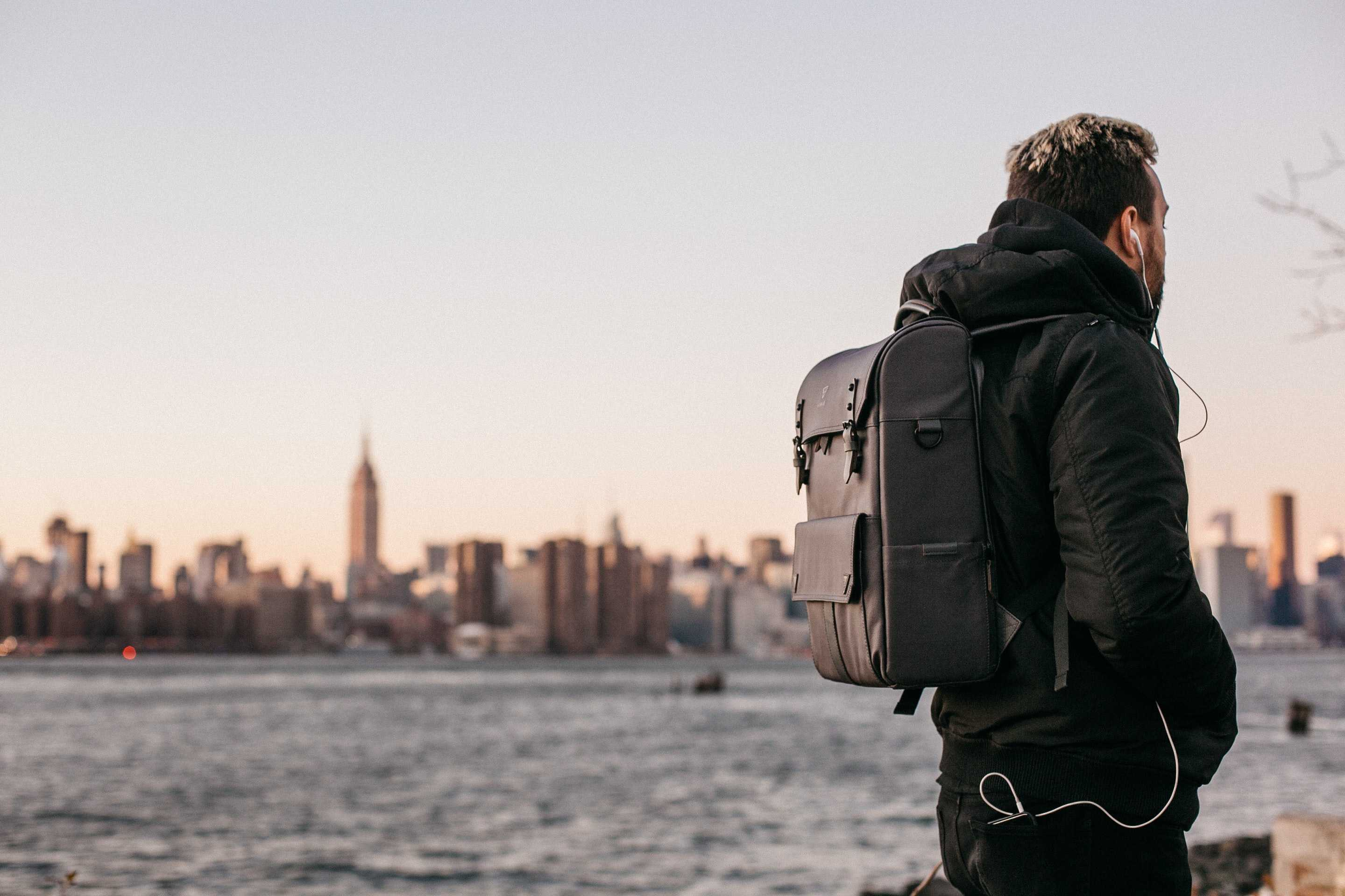 digital nomad walking with a backpack