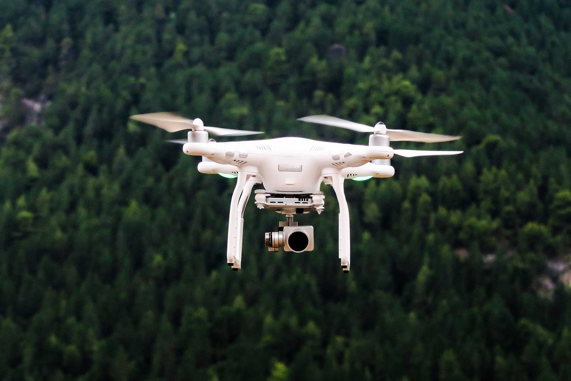 drone flying through a forest